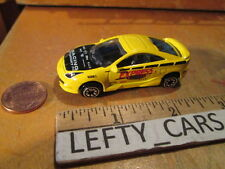TOYOTA CELICA GTS SCALE 1/64-YELLOW - RACING SPORT - IN NEAR MINT CONDITION