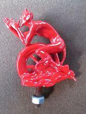 red devil riding tire,satan,hot rod, cock a snook mascot,burnout hood ornament
