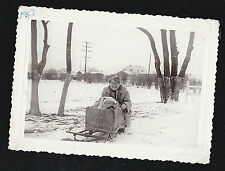 Vintage Antique Photograph Grandma Sitting in Snow Sled With Baby 1957