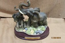 MONTEFIORI COLLECTION ITALIAN DESIGN ELEPHANT SCULPTURE ON WOOD BASE