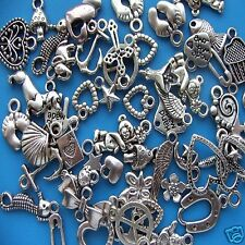 100 random mixed tibetan silver charms pendants