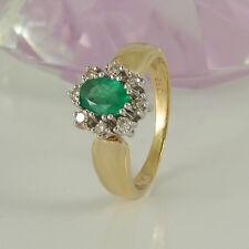 Ring in 585/- Gelb/Weißgold mit 1 Smaragd + 8 Diamanten ca 0,16 ct