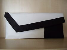 WHITE & BLACK asymmetrical faux leather clutch bag, fully lined, made in the UK.
