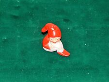 ANTIQUE GERMAN BISQUE MINIATURE SEATED BABY SANTA OR ELF WITH CANDLE HOLDER