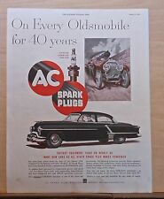1952 magazine ad for Oldsmobile & AC Spark plugs - On Every Olds for 40 Years