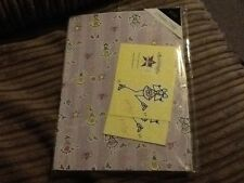 2 sheets of purple Ronnie wrapping paper and tags