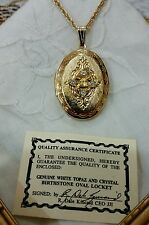 Genuine white Topaz & Crystal birthstone gold tone locket R. Dale Kincade