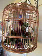 Vintage Large Wood Bird Cage with a Blue bird on a perch over   Bouquet Flowers