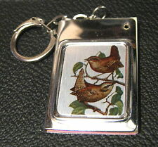 Excellent keyring with bird decoration, that contains name and telephone cards