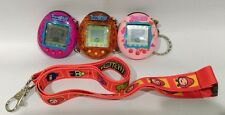 Lot of 3 Tamagotchi Connection Electronic Virtual Pets w/lanyard tested/working