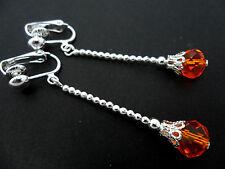 Una COPPIA DI lunghe DANGLY ARANCIONE cristallo a goccia placcato argento clip SU ORECCHINI.