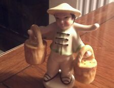 MADE IN OCCUPIED JAPAN SALT AND PEPPER ASIAN MAN CARRYING FLOWER BASKETS