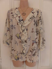 Next size 10 beige sheer blouse with pattern of birds and ruffles around neck