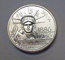 {BJSTAMPS}  1986 FRANCE 100 FRANCS .96 ozt  .900  SILVER