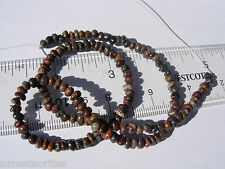 12.35 grams great small tumbled Beads of Gem Dinosaur Bone 16 inch long strand