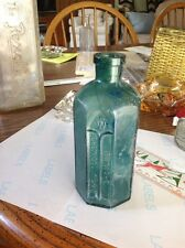 "teal green rumfords chemical works bottle 5.75"" tall."