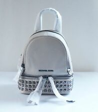NWT MICHAEL MICHAEL KORS RHEA ZIP MINI PYRAMID STUD MESSENGER BACKPACK/CEMENT