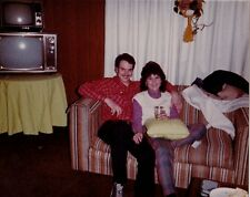 Vintage Photograph Young Couple on Couch Retro Television Sets Behind Them 1983