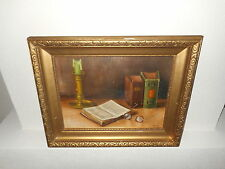 Old oil painting,{ Stillife with a book, glasses, and a candle, is signed }.