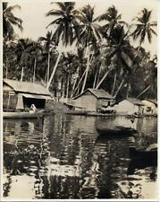 BORNEO, INDONESIA, NATIVE MALAY HOUSES ON THE BANKS OF THE RIVER NEGARA PHOTO