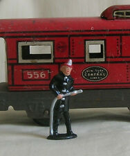 Fireman with hose, O scale tinplate model train layout figure, Reproduction