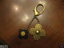 Authentic Louis Vuitton Antique Brass/Black Rock Flower Key Chain / Bag Charm