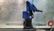 Robotic arm with linear slidebase and conveyor belt