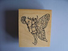 CREATIVE IMAGES RUBBER STAMPS CISTAMPS ELF HOLDING A FLOWER STAMP