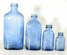 MILK OF MAGNESIA BOTTLES, 9, 7.5 , 3.5 INCHES TALL, SET OF 4