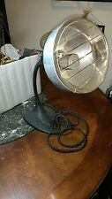 A VERY NICE VINTAGE ADJUSTABLE ELECTRIC HEATER THAT WORKS !! IT HAS A METAL BASE