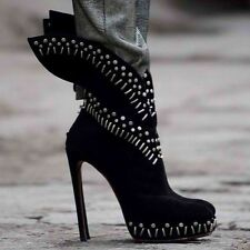 **ALAIA** Winged Studded Platform Boots **ICONIC ALAIA BOOTS** **£3000.00**