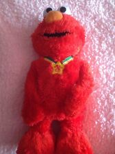 Elmo Xtra Special Edition T.M.X. 15 inches red  by Sesame Street talks, laughs