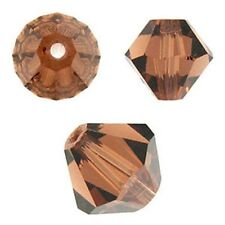 Swarovski Crystal Bicone. Smoked Topaz Color. 4mm. Approx. 144 PCS. 5328
