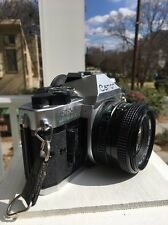 Canon AE-1 35mm SLR Film Camera with FD 50 mm lens Kit FLAWLESS
