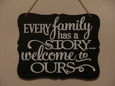Every family has a story welcome to ours, hanging sign, plaque with vinyl saying