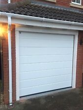 Fitted 40mm insulated electric sectional ribbed Design Garage door Installed