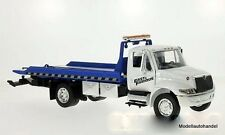 International DuraStar 4400 Flat bed, grúa blanco/azul 1:24 jada Toys