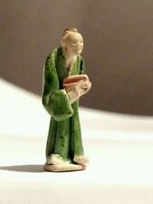 Asian Pottery Chinese Clay Mini Mud man Figurine with green glaze.