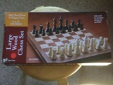 Pre Owned Solid Wood Board And CHESS Playing Pieces.  Folds In Half For Storage.
