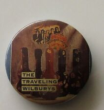 TRAVELING WILBURYS VINTAGE METAL BUTTON BADGE FROM THE 1980's OLD SHOP STOCK