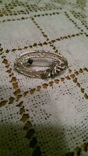 Antique Edwardian 10 kt white gold filigree Oval & Bow Pin with Real Sapphire
