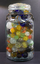 "Decorative marbles in ""King"" crown glass jar w/lid- fun colors,swirls,big/small"