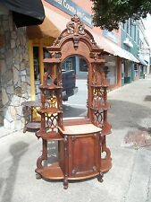 Grand Walnut Victorian Etagere With A Hand Carved Crest 19th century.