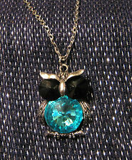 Very cute white metal chain with white metal owl with blue stones