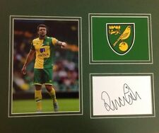 A 12 x 10 inch mounted display personally signed by Russell Martin Norwich City