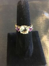 10k Gold Ring - W/Light Green Center Stone And 2 Purple Side Stones