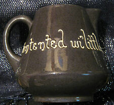 Studio art jug which was a teapot at one point with a motto approx 4 1/4 ins