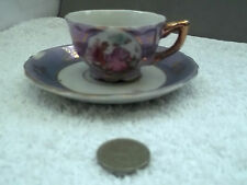 MINIATURE CUP & SAUCER  IN PURPLE   WITH COURTING COUPLE SCENE   NO MAKER