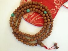 Tibetan Mala Raktu Seed mala 108 beads with Turquoise spacers