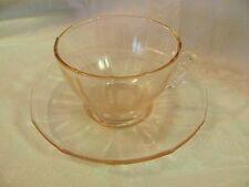Pink Depression Glass footed cup & saucer set paneled fancy handle